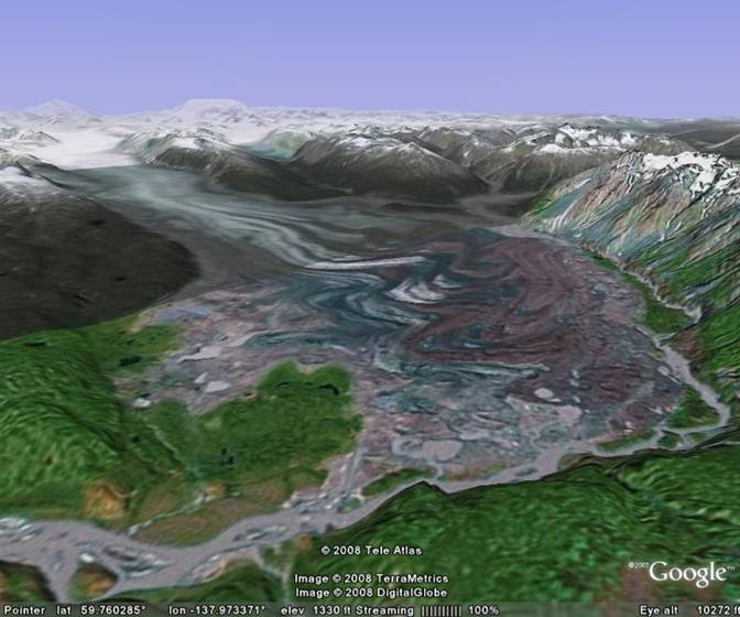 The Tweedsmuir Glacier threatens to block the           Alsek River.